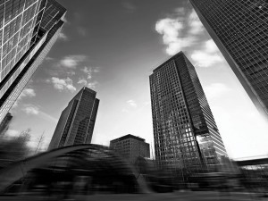 black and white city buildings in a blur