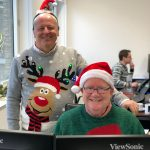 Peter Lowman and Paul Goodrich enjoying Ugly Jumper Day at Investment Quorum